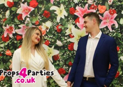 Green and pink flower wall hire