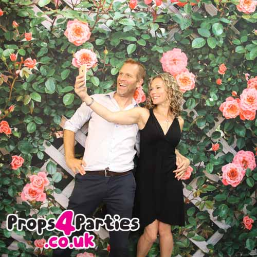 Pink and green floral flower wall hire